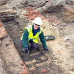 A volunteer archaeologist hard at work