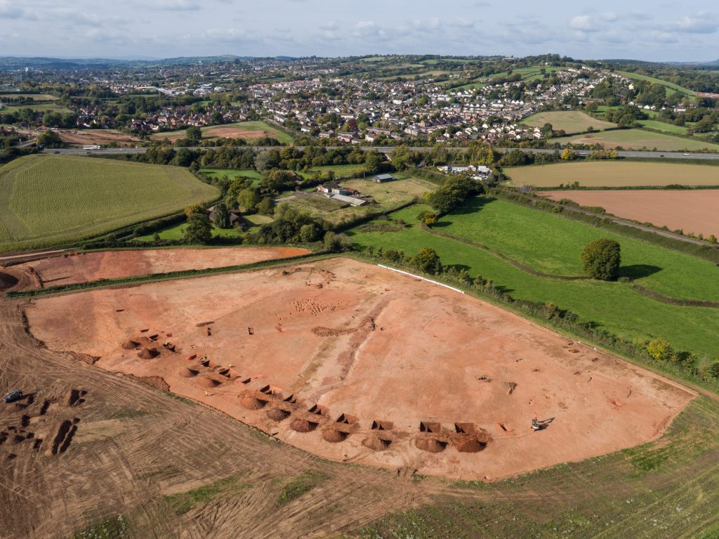 A large Bronze Age enclosure on the outskirts of Exeter excavated by Cotswold Archaeology. © Cotswold Archaeology / Adam Stanford, Aerial-Cam