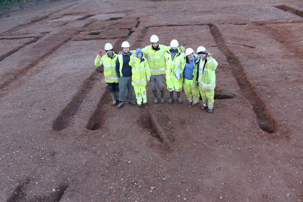 Some of Cotswold Archaeology's Exeter team inside a Roman military building of the 1st century AD at Topsham, near Exeter