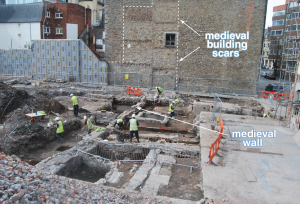 excavation area with archaeologists working