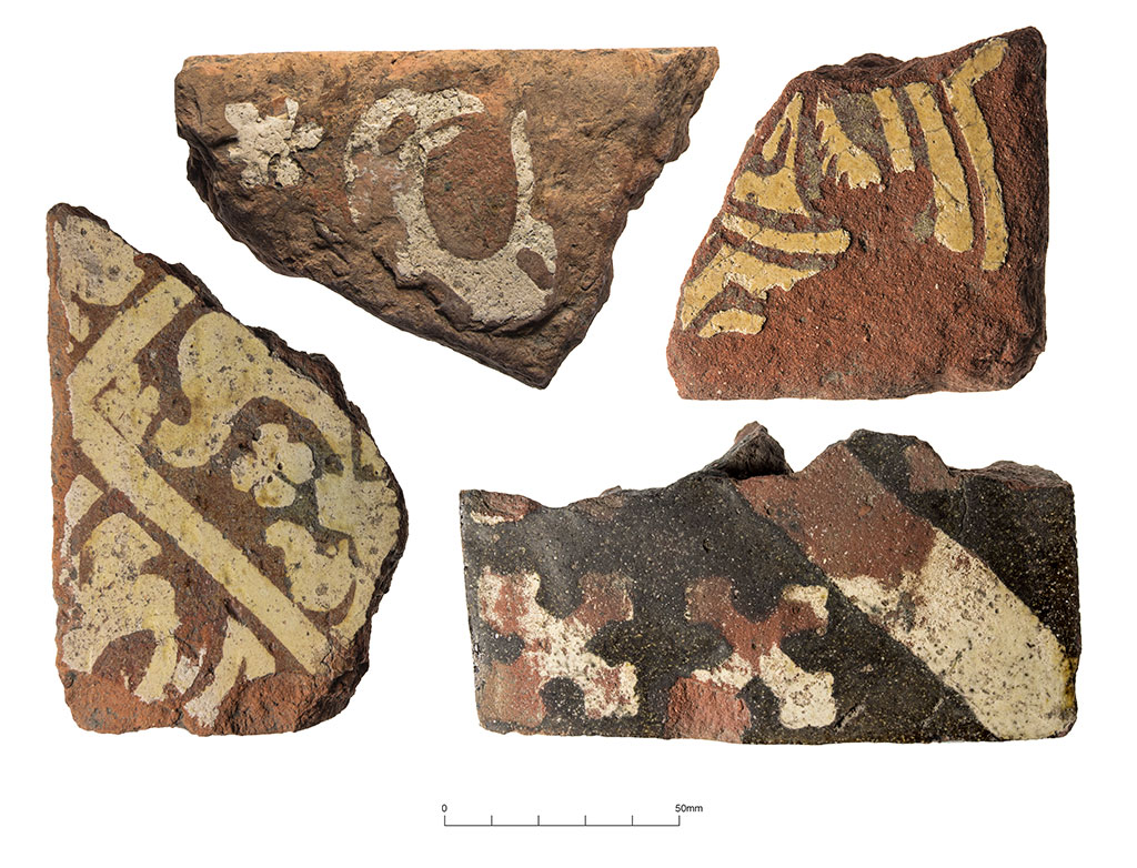 Medieval floor tiles: from top left, clockwise: Severn Valley tile (mid/late 13th-century), Bredon tile (late 13th to early 14th-century), Malvern Chase tile (possibly 14th-century), Worchester/Droitwich tile (mid 14th to mid 15th-century)