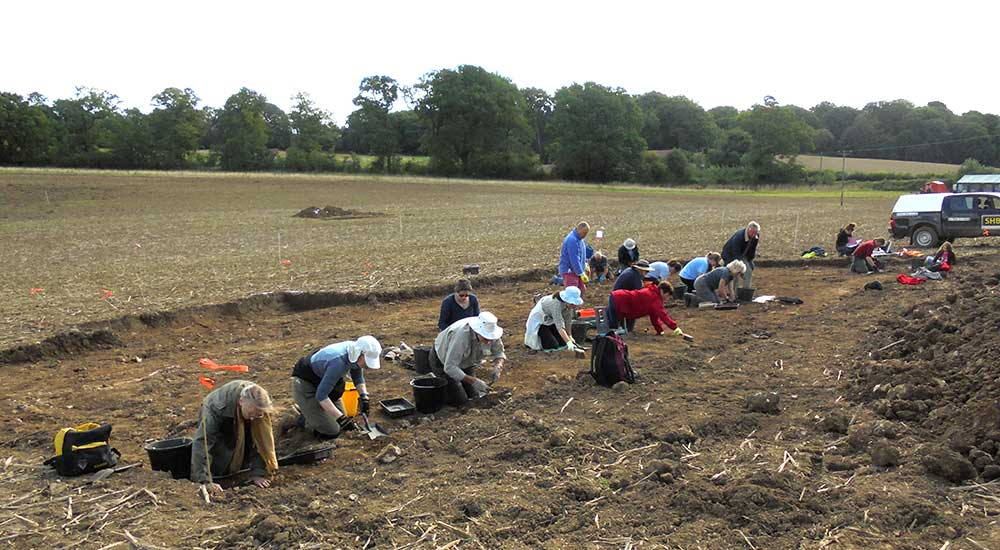 Volunteers hard at work on the potential site of a Roman barn.