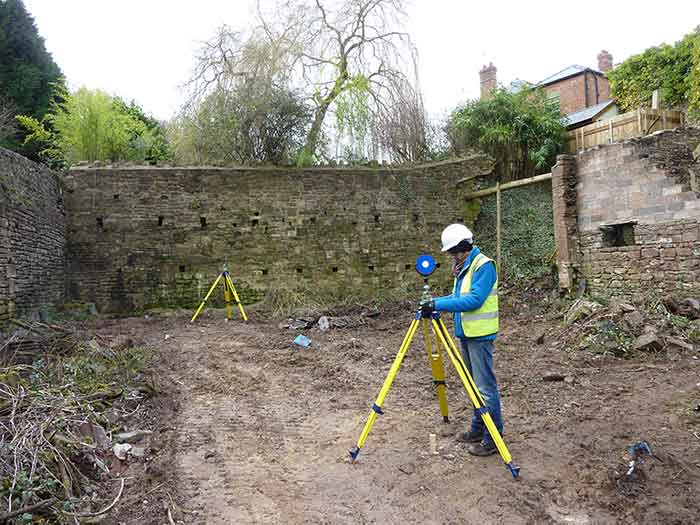 Setting up tripods and targets for scanning retaining walls, 2015