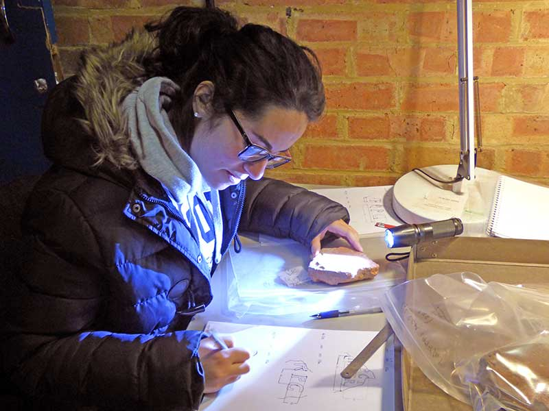 CA volunteer, Valentina Perrone, recording a stamped tile