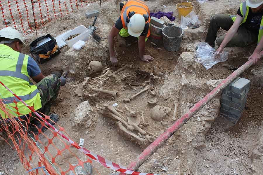 Archaeologists excavating human remains