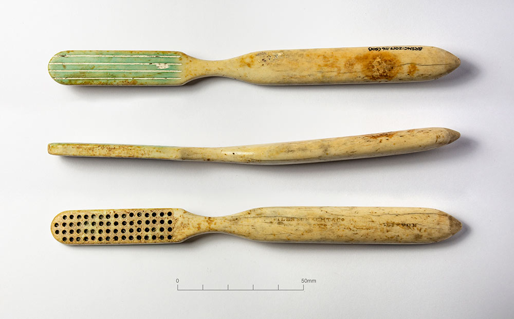 three views of post-medieval toothbrush (with missing bristles)