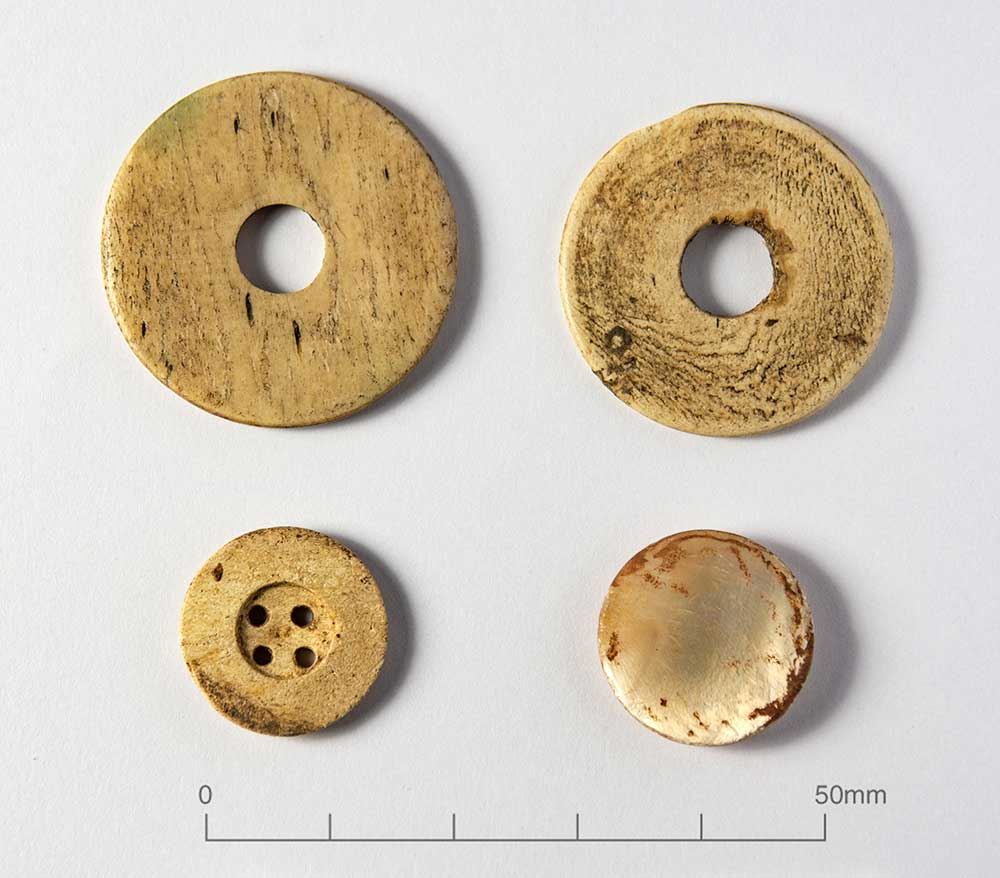 four circular bone objects - two discs and two buttons