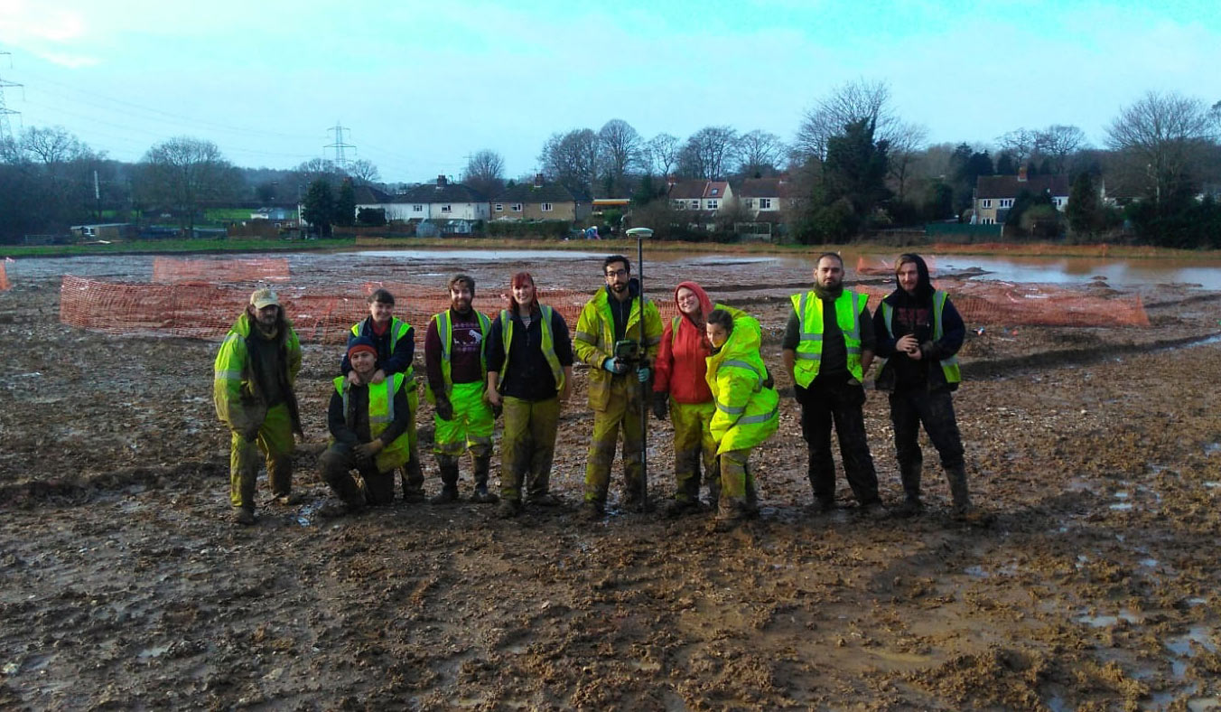 Wickham site team - group of people stanting in the middle of a muddy site