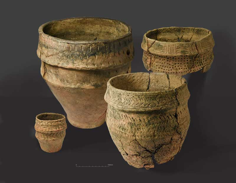 Decorated Bronze Age urns and small accessory vessel from Site 26