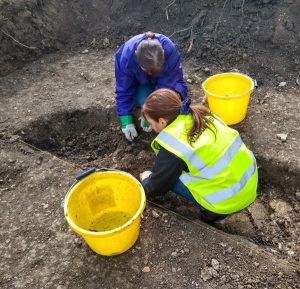 Volunteers assisting with the excavation