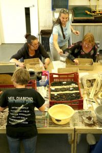 Suffolk office volunteers assisting with processing of the finds and soil samples