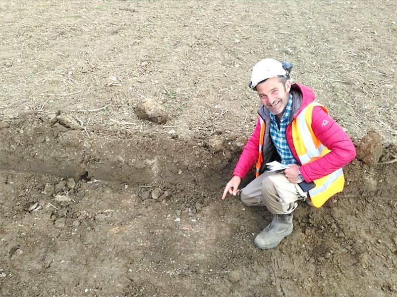 Matt smiling at the prospect of uncovering the mosaic