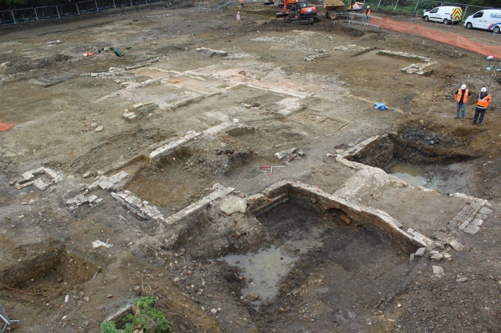 The demolished remnants of the post-medieval domestic buildings within, and contemporary bridge across, the moat