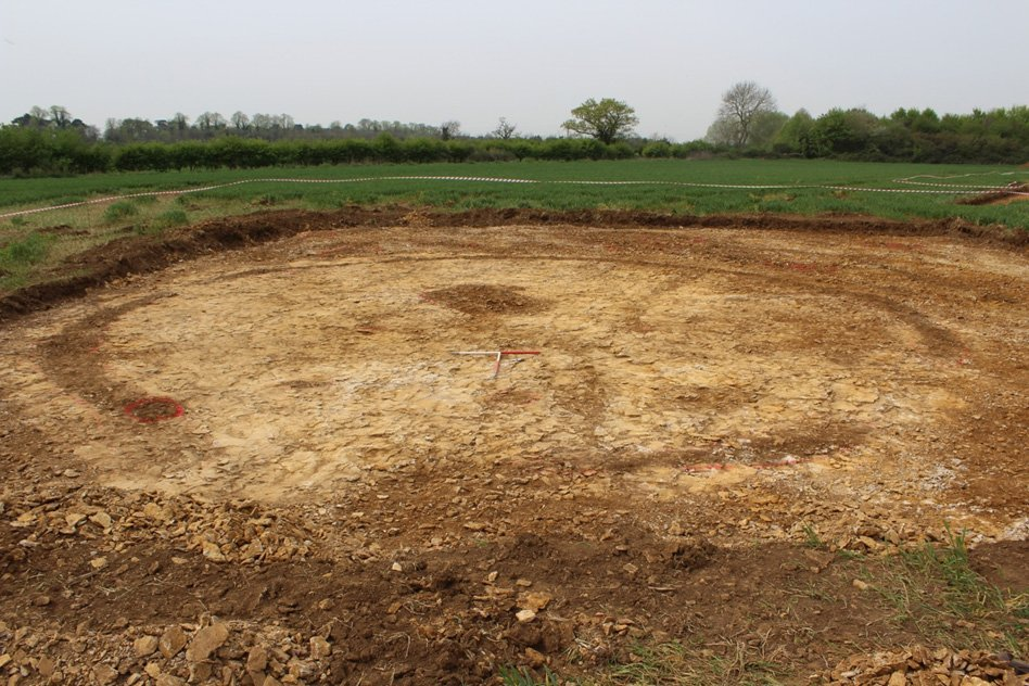 A Middle Iron Age roundhouse with the entrance to the fore, looking north-west