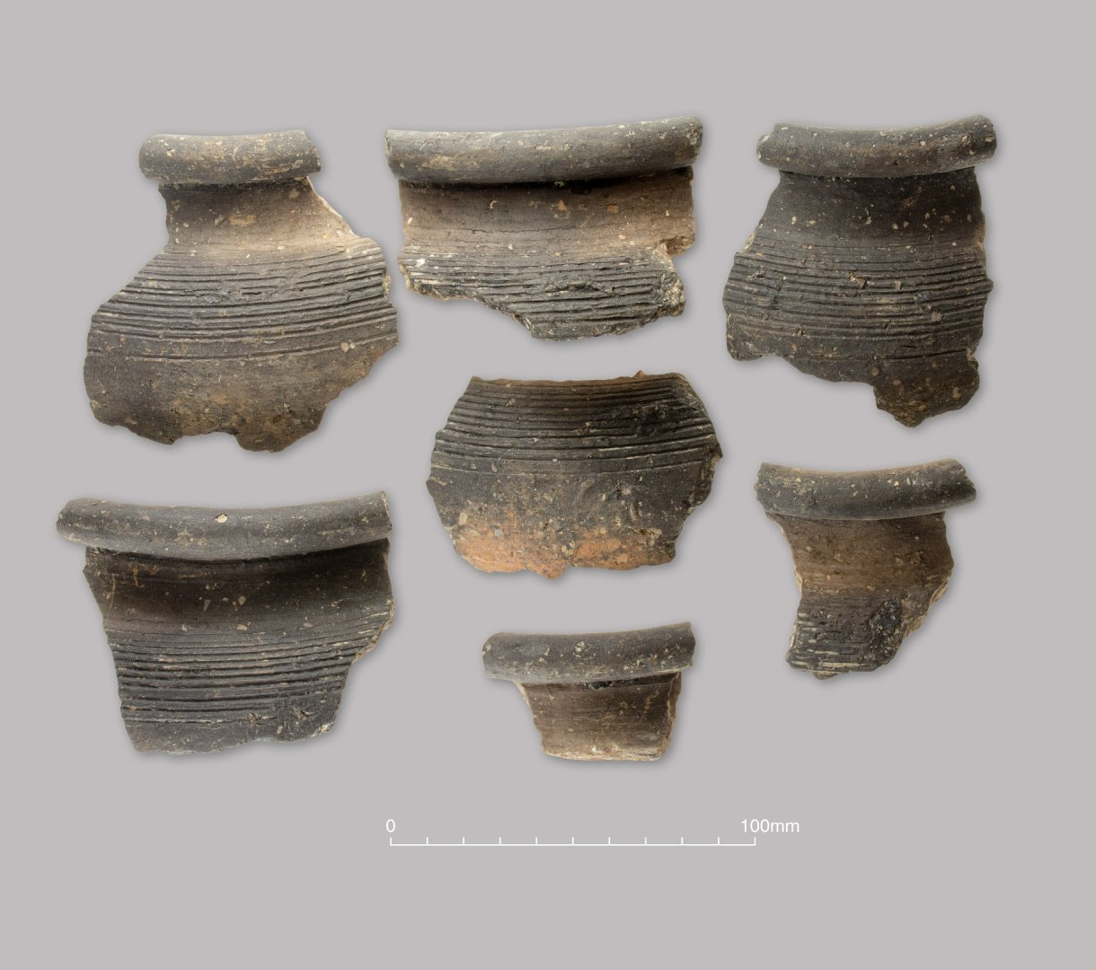 Grog-tempered ware jar with combed shoulder. Early Roman (c. 50–150 AD)