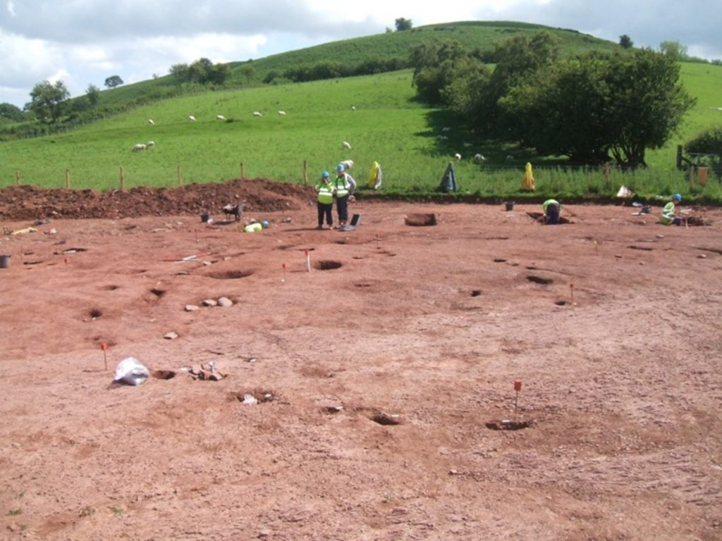 Recording a roundhouse beneath Pen-y-Crug hillfort