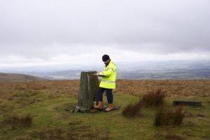 Richard Young, a member of the walkover survey team, reaches the Brecon Beacons