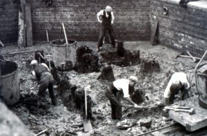 1930s construction work uncovered wooden piles at Upper Quay Street. Gone are the days when sites featured three-piece suits and cloth caps, but the muddy conditions will be familiar to any generation of archaeologists