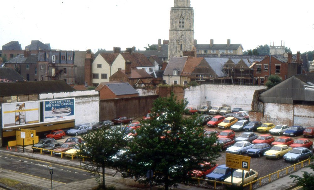 The Upper Quay Street site in 1989, prior to redevelopment, looking north from the Quay Street/Upper Quay Street junction towards St Nicholas' church. The site is now occupied by flats
