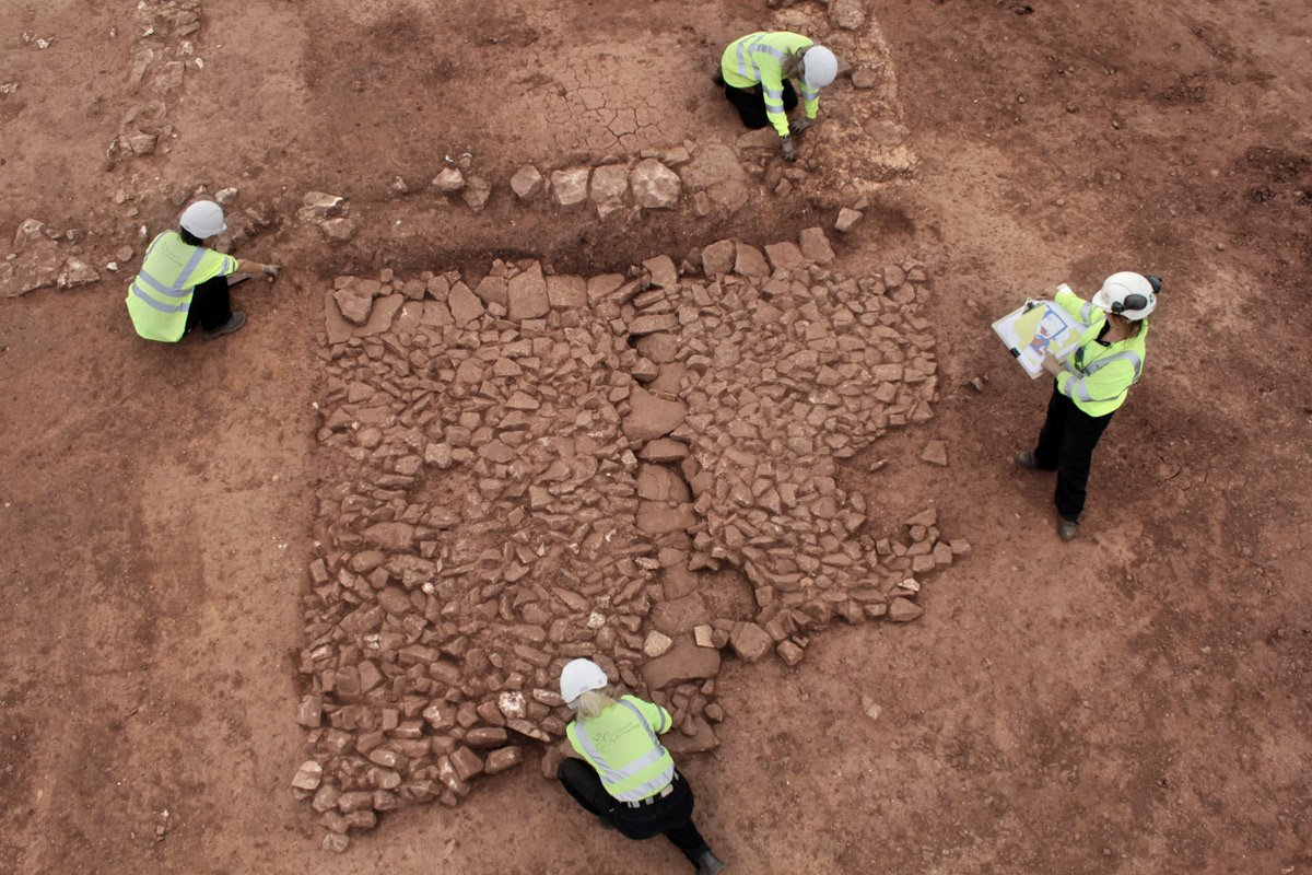 aerial photo fo people excavating a stone structure